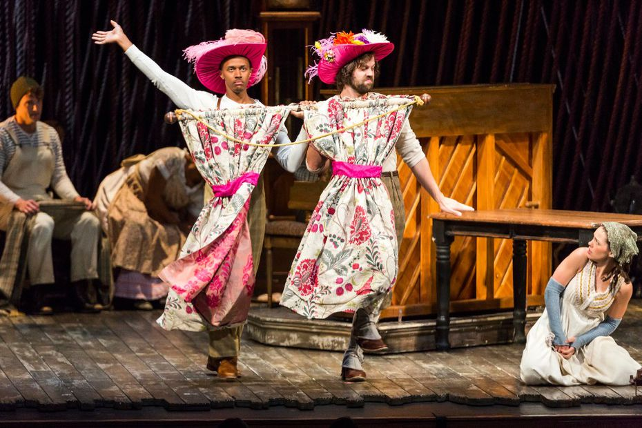 """Anthony Chatmon II (left) and Darick Pead as the Stepsisters perform with Laurie Veldheer as Cinderella during the opening night performance Tuesday of the Fiasco Theater production of """"Into The Woods"""" at the Winspear Opera House."""