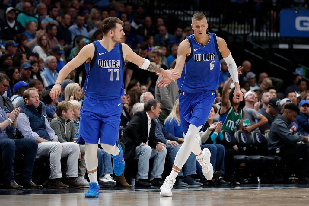 FILE - Mavericks guard Luka Doncic (77) and forward Kristaps Porzingis (6) celebrate a basket by Porzingis in the second half of a game against the Portland Trail Blazers in Dallas on Sunday, Oct. 27, 2019.