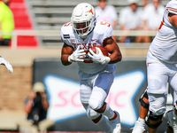 Running back Bijan Robinson #5 of the Texas Longhorns runs the ball during the first half of the college football game against the Texas Tech Red Raiders on September 26, 2020 at Jones AT&T Stadium in Lubbock, Texas.