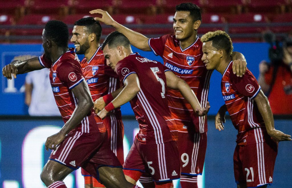 FC Dallas midfielder Javier Morales (11, second from left) and his teammates celebrates a goal from a penalty kick in the 89th minute of the second half of an MLS soccer game between FC Dallas and the Colorado Rapids on Tuesday, June 27, 2017 at Toyota Stadium in Frisco, Texas. Morales earned a penalty kick after he was grabbed on the chest by Colorado Rapids defender Kortne Ford (24). FC Dallas won 3-1. (Ashley Landis/The Dallas Morning News)