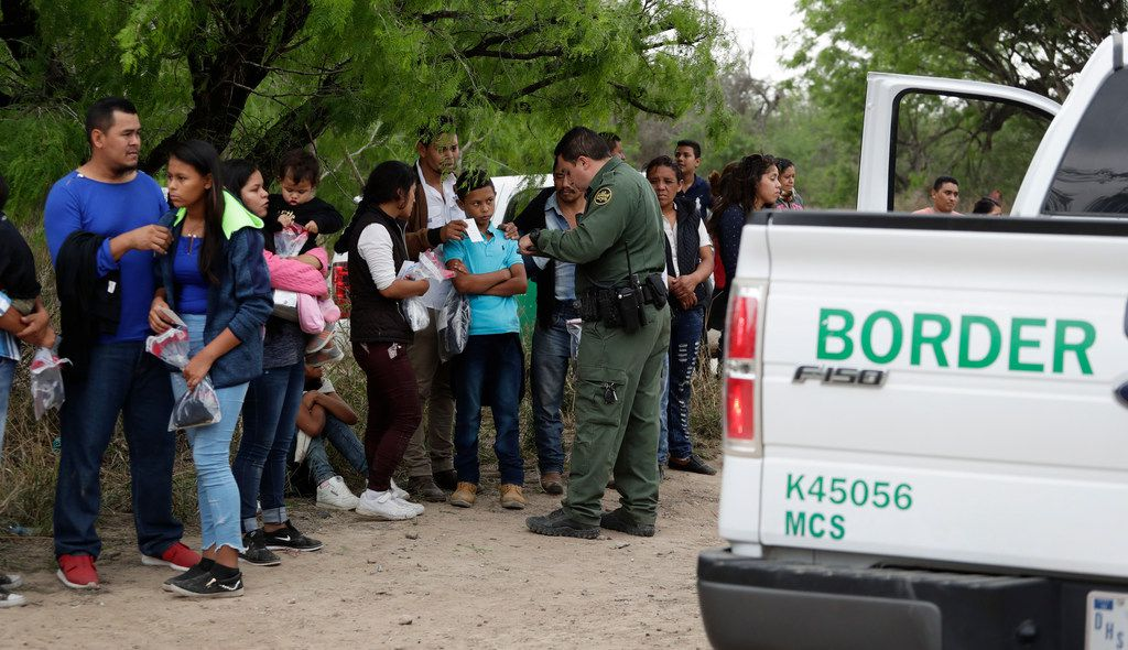 A Border Patrol agent near McAllen checked the names and documents of families who crossed the border earlier this month. Immigration authorities say they expect the surge of families from Central American to multiply in the coming months.