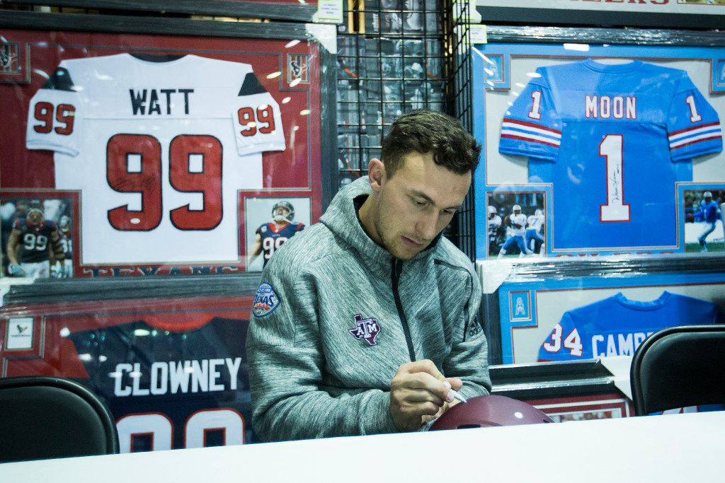Former Texas A&M and Cleveland Browns quarterback Johnny Manziel signs autographs during an appearance at  Stadium Signatures at Katy Mills Mall in the week leading up to Super Bowl LI, held at Houston's Reliant Staidum.