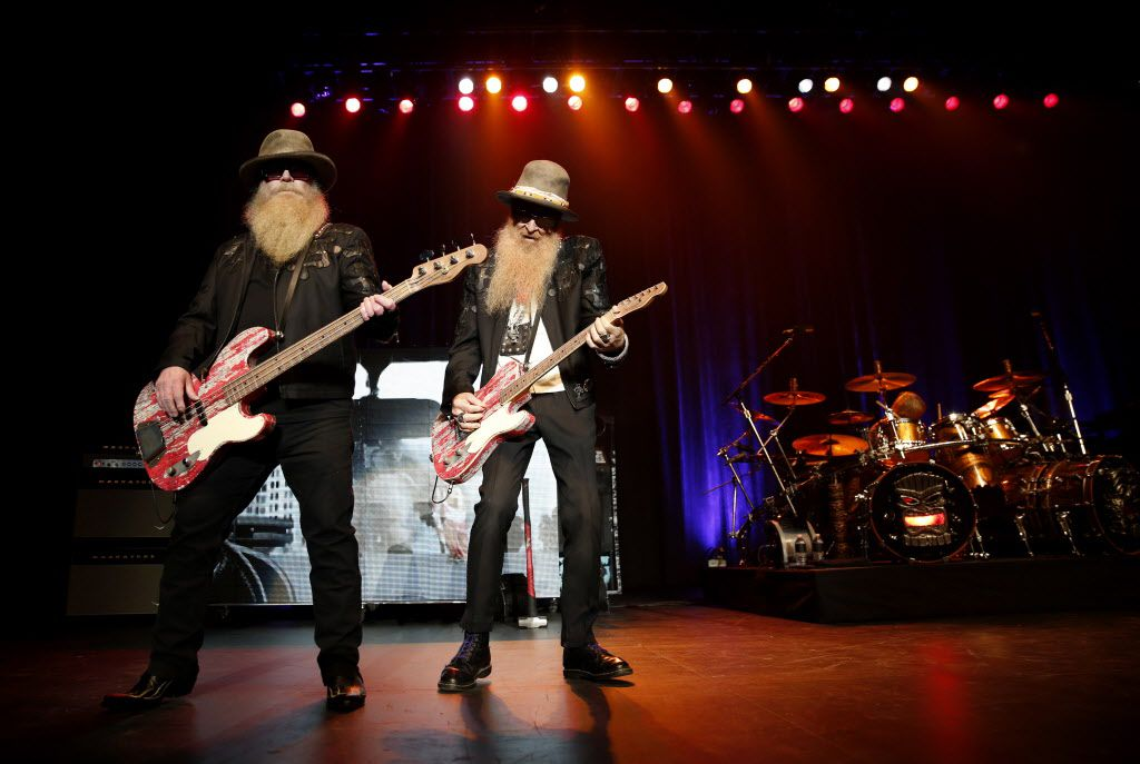 Dusty Hill (left) and Billy Gibbons were front and center as ZZ Top performs at the Music Hall at Fair Park in Dallas on Sept. 4, 2015. (Rose Baca/The Dallas Morning News)