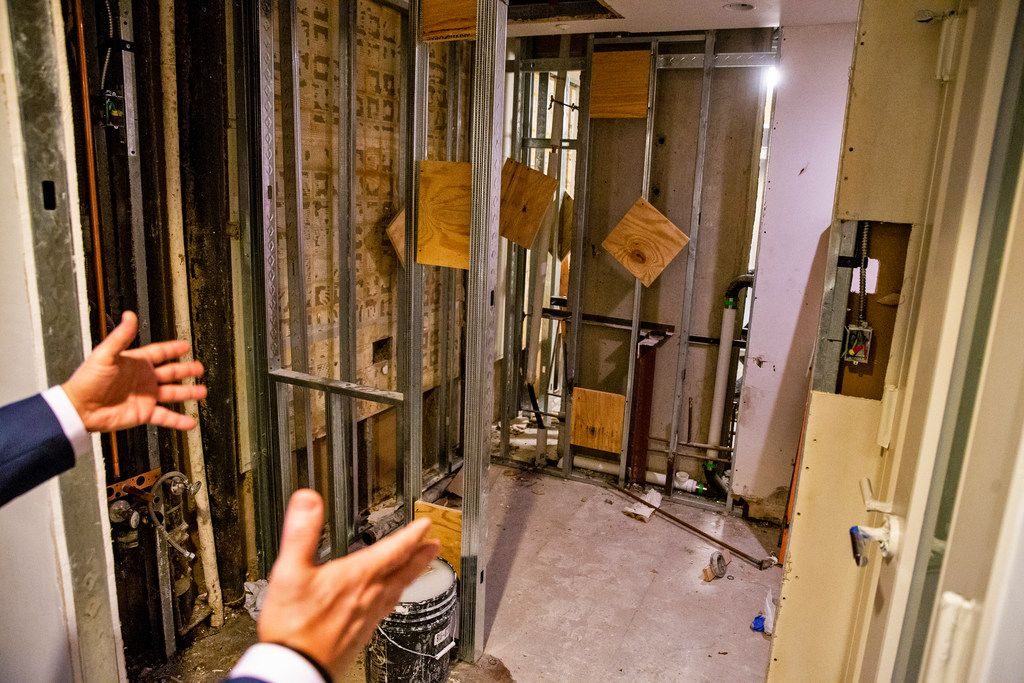 Chris Pilavakis, general manager of Renaissance Dallas hotel, points to where the new bathrooms will be in a room that is being renovated at the Renaissance Dallas Hotel on Friday, October 12, 2018. The hotel removed bathtubs, and opted for showers in part to attract younger patrons.