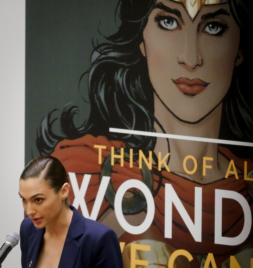 """Gal Gadot, star of the new Wonder Woman movie, speaks during a U.N. meeting to designate Wonder Woman as an """"Honorary Ambassador for the Empowerment of Women and Girls,"""" Friday, Oct. 21, 2016 at U.N. headquarters. (AP Photo/Bebeto Matthews)"""