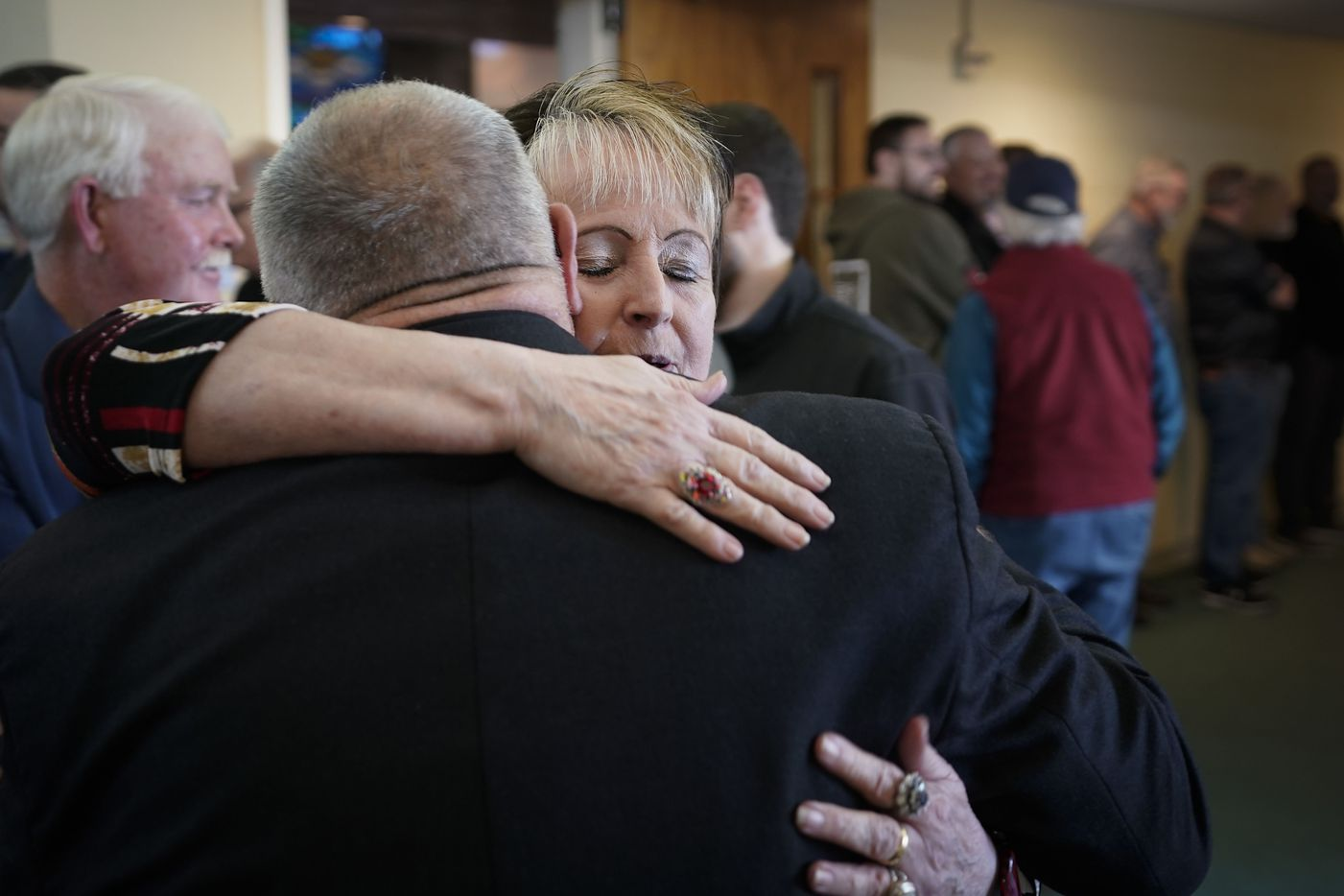 Cheryl Linam hugs Carl Chinn, the president of Faith Based Security Network, during a  church safety seminar at North Pointe Baptist Church on Sunday, Jan. 26, 2020, in Hurst, Texas. Linam lost her 7-year old daughter in a shooting at First Baptist Church in Daingerfield, Texas in 1980.