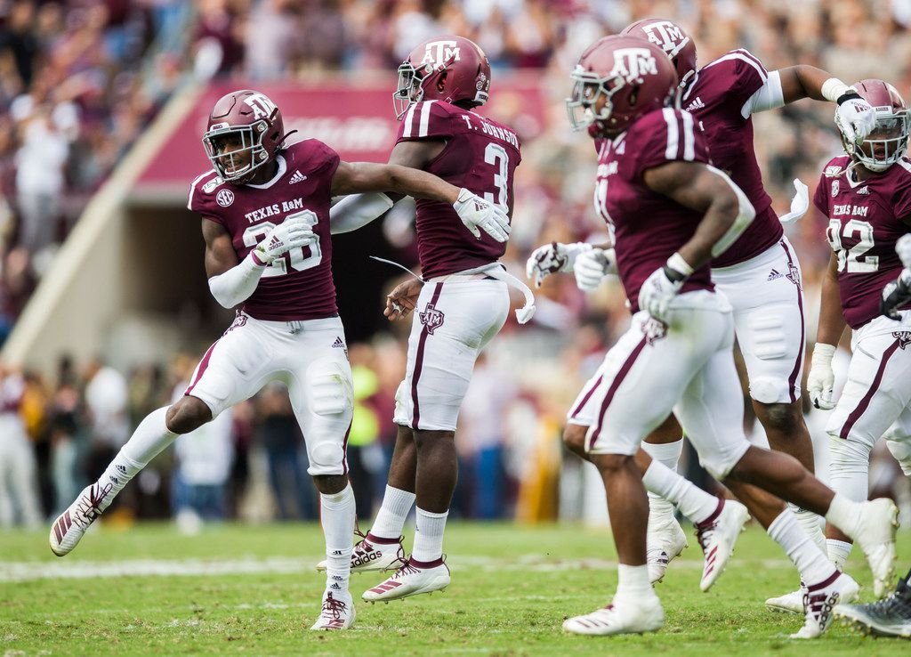 Texas A&M Aggies defensive back Demani Richardson (26) celebrates an interception with Texas A&M Aggies defensive lineman Tyree Johnson (3) during the second quarter of a college football game between Texas A&M and Alabama on Saturday, October 12, 2019 at Kyle Field in College Station, Texas.