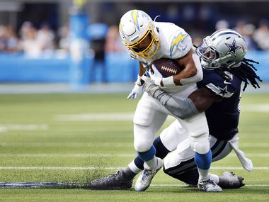 Dallas Cowboys linebacker Jaylon Smith (9) made a diving tackle of Los Angeles Chargers running back Austin Ekeler (30) during the second quarter at SoFi Stadium in Inglewood, California, Sunday, September 19, 2021.