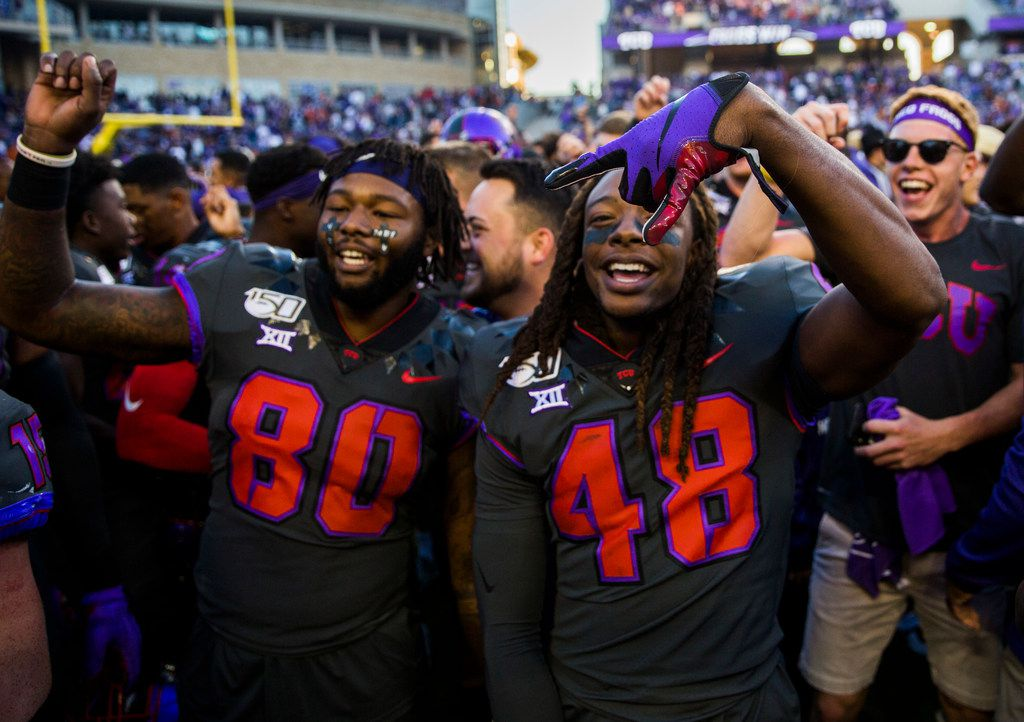 The TCU Horned Frogs were all smiles after beating Texas 37-27 Saturday. (Ashley Landis/The Dallas Morning News)
