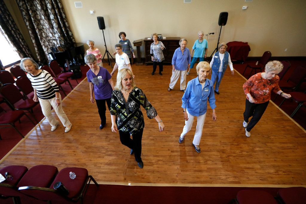 Cyndi Dorber (center) leads a line dancing class for seniors at Atria Canyon Creek in Plano.