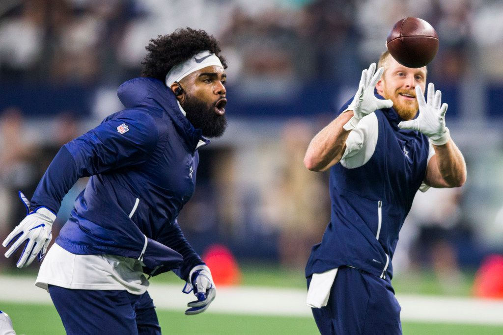 Dallas Cowboys running back Ezekiel Elliott (21) and wide receiver Cole Beasley (11) warm up before an NFL game between the Dallas Cowboys and the New York Giants on Sunday, September 16, 2018 at AT&T Stadium in Arlington, Texas. (Ashley Landis/The Dallas Morning News)