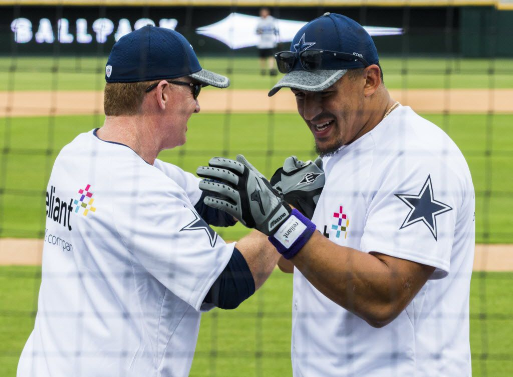 Dallas Cowboys head coach Jason Garrett high-fives defensive tackle Tyrone Crawford (98) after his at bats during their annual Home Run Derby contest on Tuesday, May 17, 2016 at Dr. Pepper Ballpark in Frisco, Texas. Proceeds benefit The Salvation Army Greater Metroplex Command. (Ashley Landis/The Dallas Morning News)
