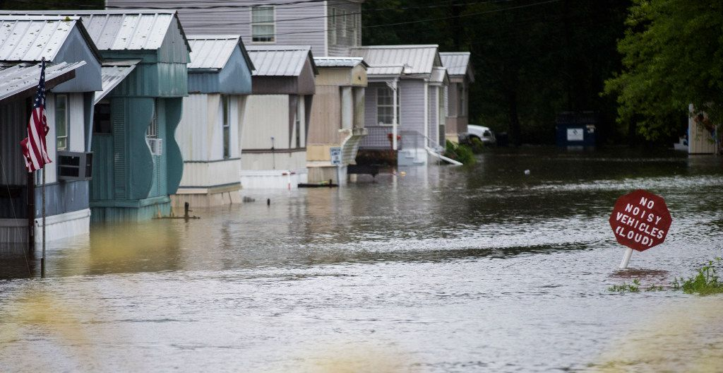 High water from Hurricane Harvey takes over a group of mobile homes in Lumberton.