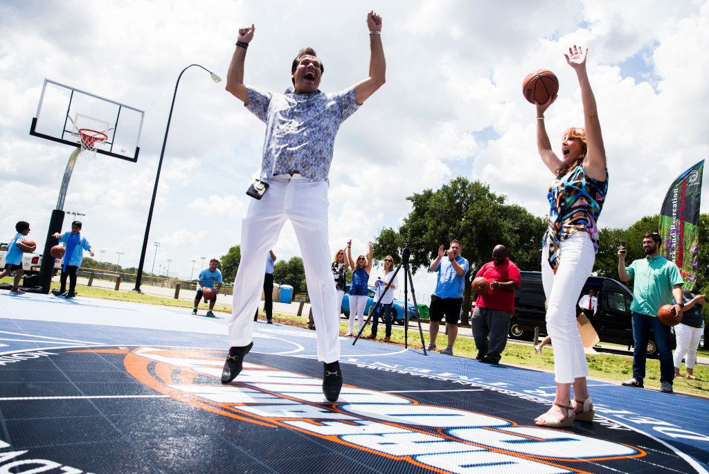 Wayne Nugent of WorldVentures celebrates with Nancy Lieberman after making a half-court, over-the-shoulder shot at Dallas' new Dream Courts.