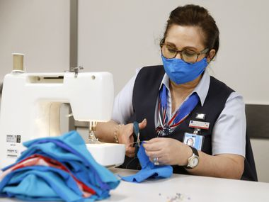 American Airlines employee Beatrice Austin makes masks for employees at DFW International Airport on Wednesday, April 8, 2020. The airline is making all employees wear masks starting Friday, except in non-public areas where social distancing can be maintained.