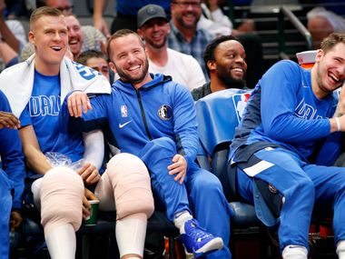 Dallas Mavericks guard J.J. Barea (center) laughs with teammates Kristaps Porzingis (left) and Luka Doncic (right) at the American Airlines Center in Dallas, Wednesday, November 20, 2019.