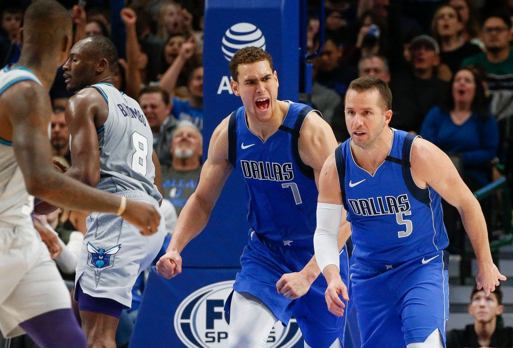 Dallas Mavericks guard J.J. Barea (5) and forward Dwight Powell (7) celebrate scoring during the second half of an NBA basketball game between the Dallas Mavericks and the Charlotte Hornets on Saturday, Jan. 4, 2019 at American Airlines Center in Dallas.