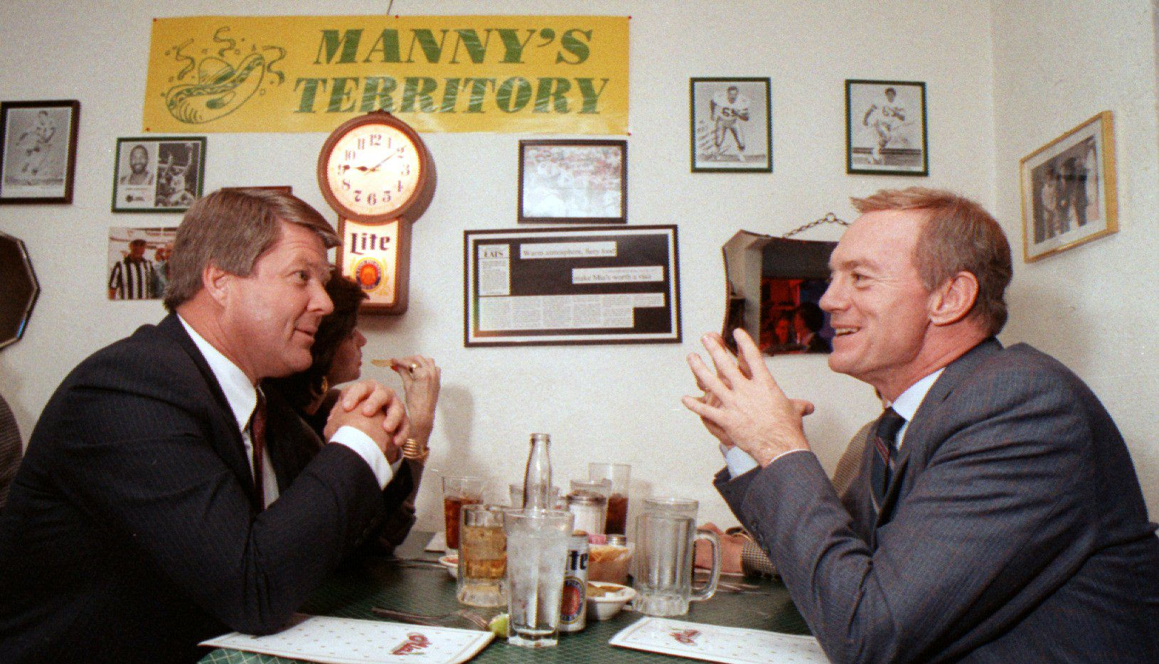 Jerry Jones sits with then University of Miami coach Jimmy Johnson at a Dallas restaurant. Jones would hire Johnson to replace Tom Landry soon after.