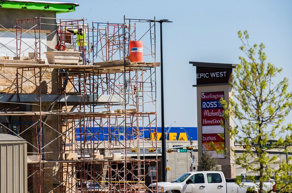 Retail stores are under construction near the new Ikea at the intersection of State Highway 161 and Mayfield Road in Grand Prairie. (Ashley Landis/The Dallas Morning News)