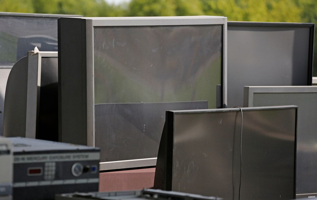 Old televisions sit in the recycle area of the McCommas Bluff Landfill at 5100 Youngblood Road in Dallas, photographed on Thursday, August 16, 2018. (Louis DeLuca/The Dallas Morning News)