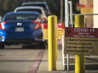 Signage for COVID-19 drive-thru testing outside of Frontline ER in Dallas, on Tuesday, Dec. 01, 2020.