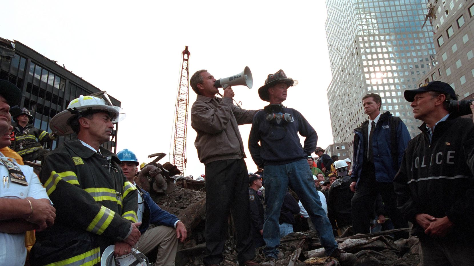 Standing atop rubble with retired New York City firefighter Bob Beckwith, Former President George W Bush rallies firefighters and rescue workers during an impromptu speech at the site of the collapsed World Trade Center in New York City, N.Y., Sept. 14, 2001.