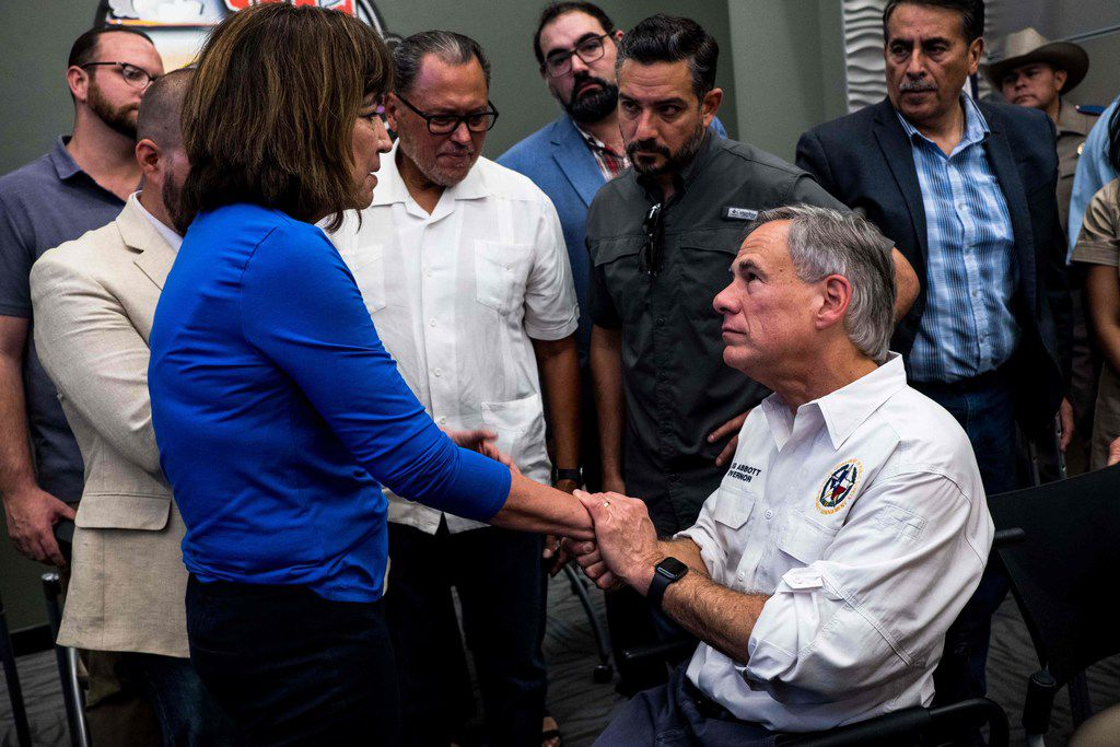 """Rep. Evelina """"Lina"""" Ortega, D-El Paso, shakes the hands of Texas Gov. Greg Abbott after a press briefing, following a mass fatal shooting, at the El Paso Regional Communications Center in El Paso, Texas, on August 3, 2019. On Friday, Ortega and other House Democrats from El Paso blasted Abbott on social media for criticizing a 1982 U.S. Supreme Court ruling that said the state has to provide education for unauthorized immigrant children."""