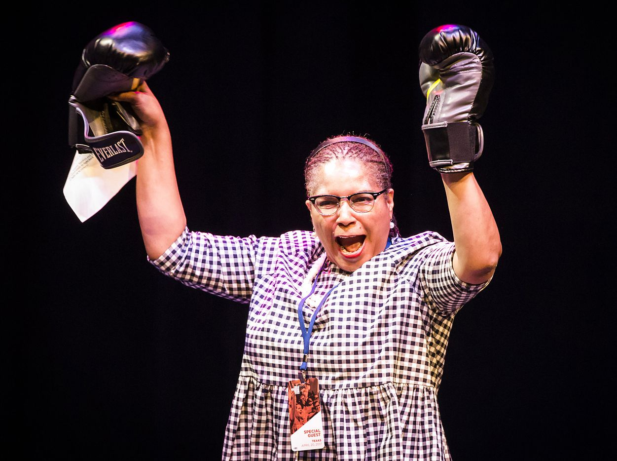 "Tarrant Country Democratic Party chair Deborah Peoples holds up boxing gloves as she takes the stage during a rally at the Verizon Theater on Thursday, April 20, 2017, in Grand Prairie, Texas. Sanders, the runner-up in the 2016 Democratic contest for president, appeared in North Texas as part of a national tour urging Democrats to ""Come Together, Fight Back"" against the agenda of President Trump."