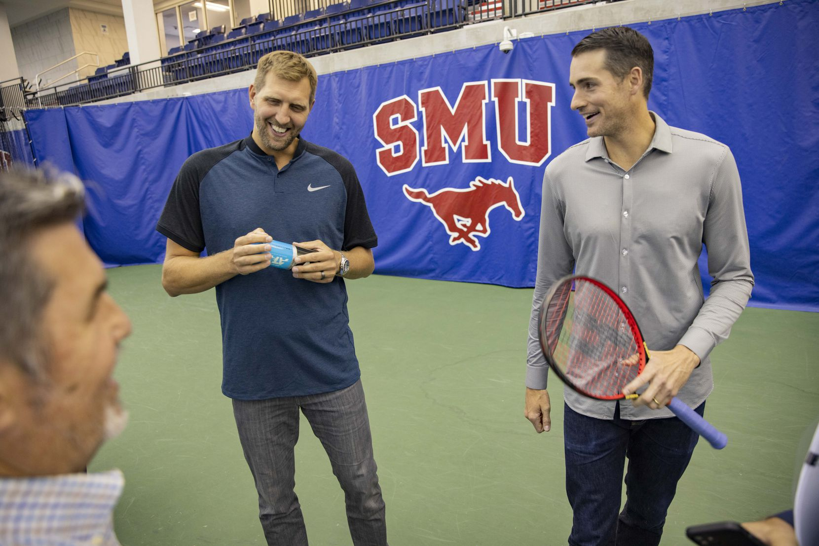 Dallas Mavericks star Dirk Nowitzki (left) and John Isner, 15-Time ATP Tour Champion, chat following a press conference to announce a new ATP tennis tour event coming to Dallas at the SMU Styslinger/Altec Tennis Complex on Wednesday, May 19, 2021, in Dallas.