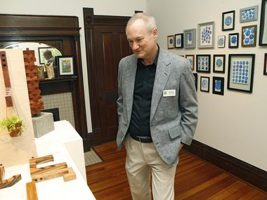 In this file photo, Michael Coleman, board president for the ArtCentre of Plano, views exhibit on display at its location at 901 18th St. in Plano.