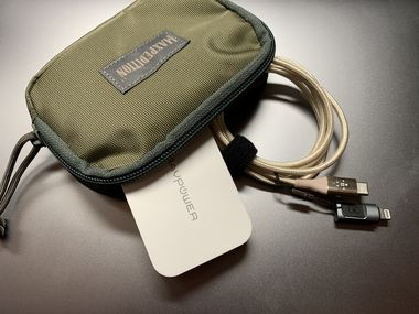 I keep a small Ravpower USB-C charger and a long charging cable (with an iPhone adapter) in a small Maxpedition pouch.