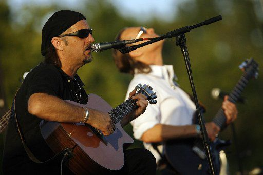 ORG XMIT: *S19134ADD* Jimmy LaFave, left, and lead guitarist John Inmom perform August 9 at the Amphitheater at Oak Point Park in Plano. LaFave was the warm-up act for Gary P. Nunn.