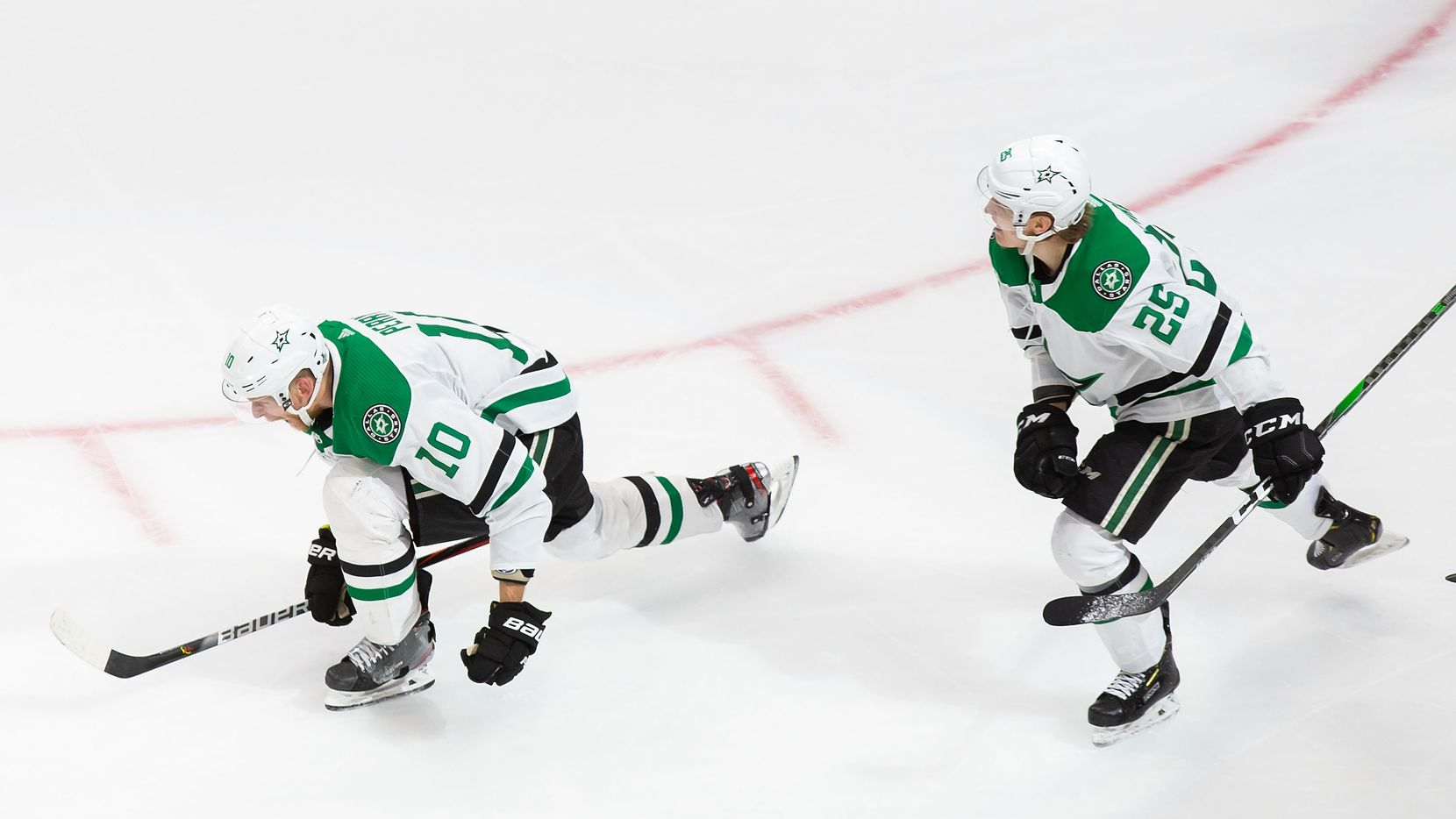 Corey Perry (10) and Joel Kiviranta (25) of the Dallas Stars celebrate Perry's game winning goal against the Tampa Bay Lightning during Game Five of the Stanley Cup Final at Rogers Place in Edmonton, Alberta, Canada on Saturday, September 26, 2020.