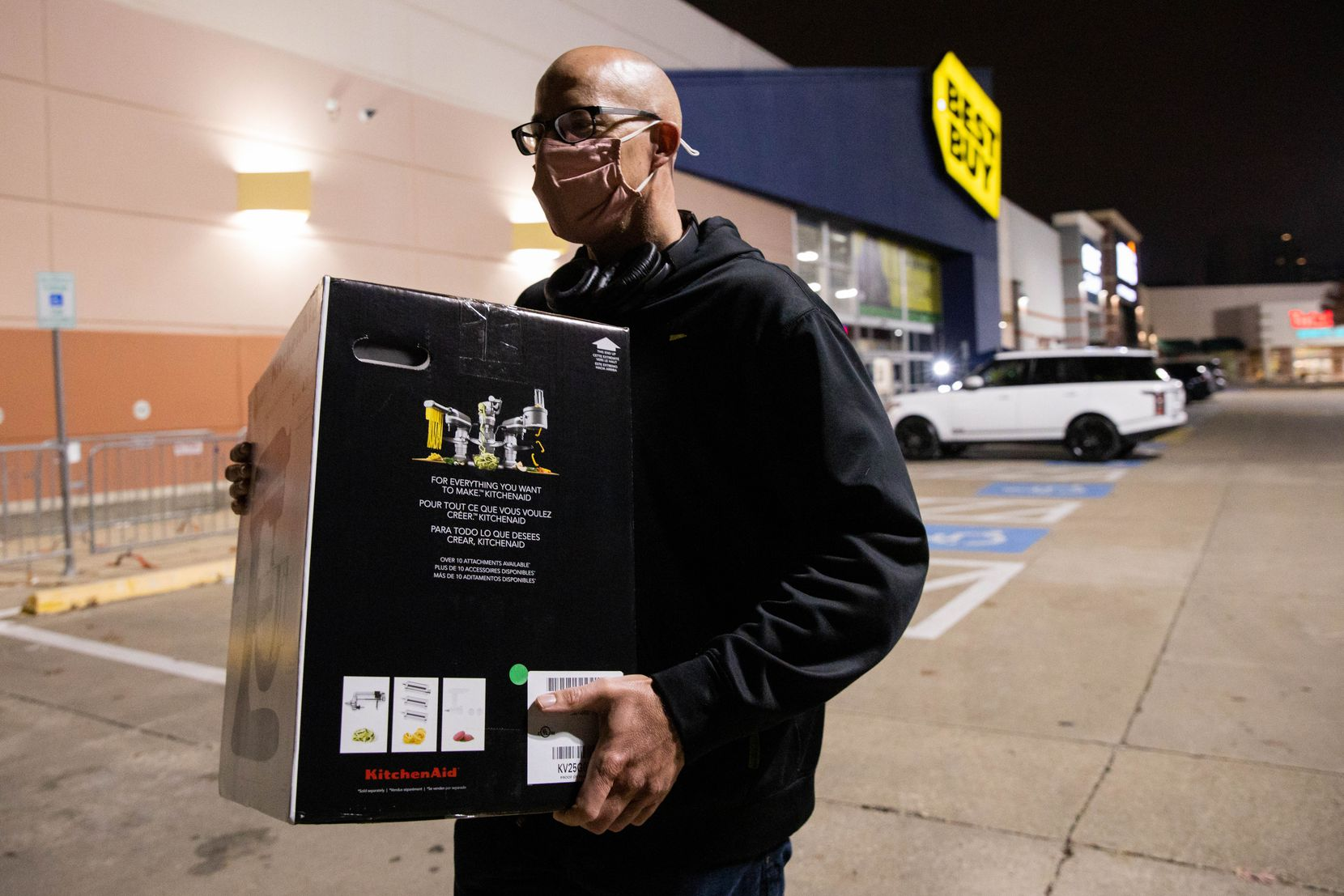 "Sean Berube, who was visiting from Arizona, walked out of Best Buy with a KitchenAid mixer on Black Friday. Berube waited in line to buy the mixer for his wife before doors opened at 5 a.m. ""This was the only one,"" Berube said. ""I got lucky."""