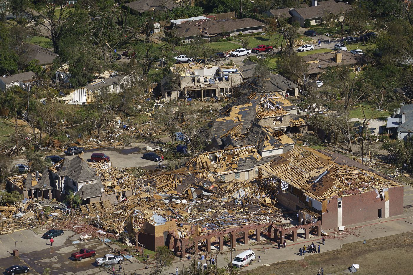 Damage to Primera Iglesia Bautista Mexicana church (bottom) just off  Walnut Hill Lane and homes behind it is seen in an aerial view of tornado damage on Monday, Oct. 21, 2019, in Dallas.
