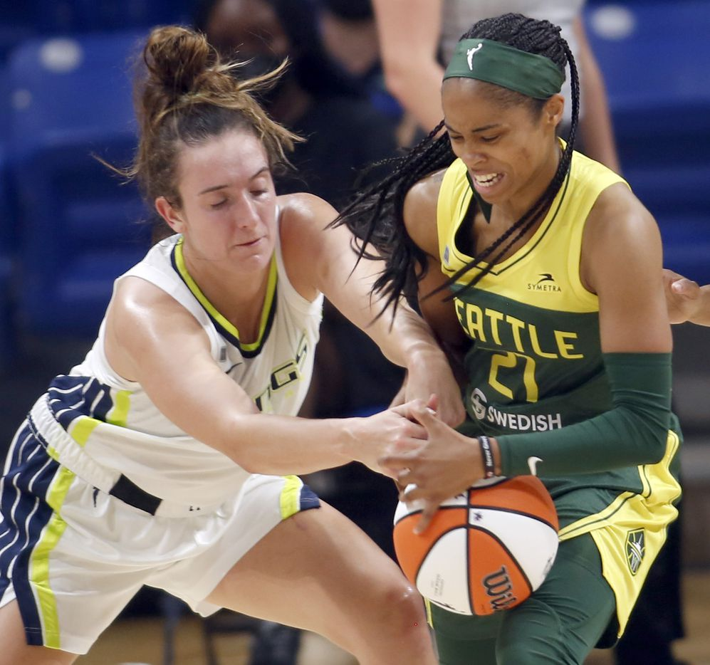 Dallas Wings guard Marina Mabry (3) tangles with Seattle guard Jordin Canada(21) for possession of a loose ball during second half action. The Wings hosted the Storm for their WNBA 2021season home opener at UTA's College Park Center in Arlington on May 22, 2021. (Steve Hamm/ Special Contributor)