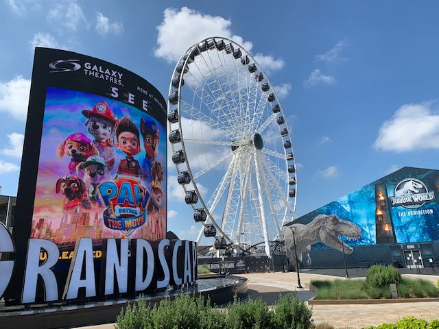 The 180-foot-tall Grandscape Wheel opened for its first riders on Sept. 10 at the Grandscape entertainment center in The Colony.