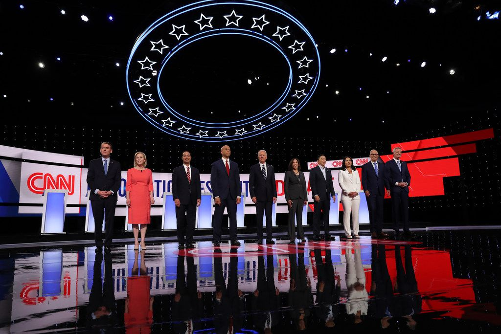 Joe Biden, shown at center left with rivals at the second debate in Detroit in July, leads Beto O'Rourke in a new poll of likely Texas presidential primary voters, 24% to 18%. Elizabeth Warren is running third, with 15%, to Bernie Sanders' 4th-place ranking of 13%. Julián Castro, third from left, is in a tie for 5th place with Kamala Harris, each with 4% in the Texas Lyceum poll.