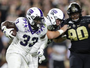 FILE - TCU running back Sewo Olonilua (33) runs the ball against Purdue during the second half of a game in West Lafayette, Ind., on Saturday, Sept. 14, 2019. (AP Photo)