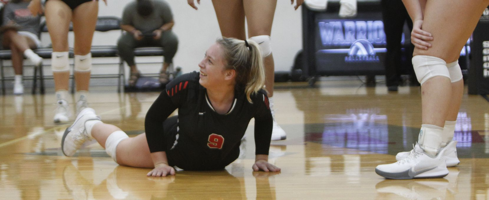 Arlington Martin's Mackenzie Mundell (9) was all smiles as she gets to her feet after making a diving attempt to keep the ball in play during second set play against South Grand Prairie. The two teams played their volleyball match at Arlington Martin High School in Arlington on September 14, 2021. (Steve Hamm/ Special Contributor)