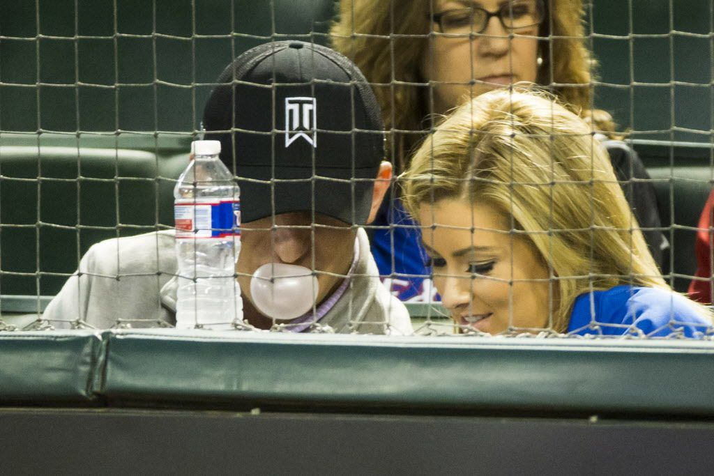 Johnny Manziel blows a bubble as he watches from the seats behind home plate as the Texas Rangers face the Los Angeles Angels at Globe Life Park on Tuesday, April 14, 2015, in Arlington. (Smiley N. Pool/The Dallas Morning News)