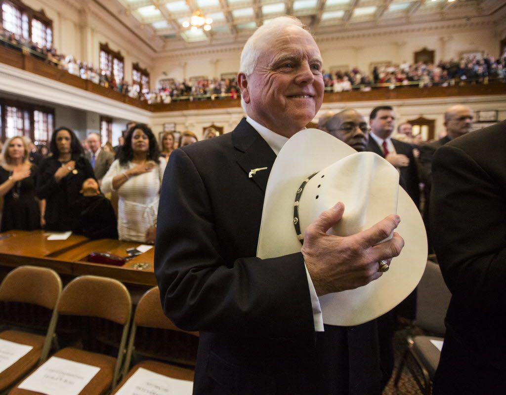 Agriculture Commissioner Sid Miller held his cowboy hat over his heart during the singing of the national anthem during the first day of the 84th legislative session at the Texas state Capitol in Austin. (2015 File Photo/Ashley Landis)
