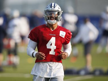 Dallas Cowboys quarterback Dak Prescott (4) laughs after completing a drill during training camp at the Dallas Cowboys headquarters at The Star in Frisco, Texas on Sunday, August 16, 2020.