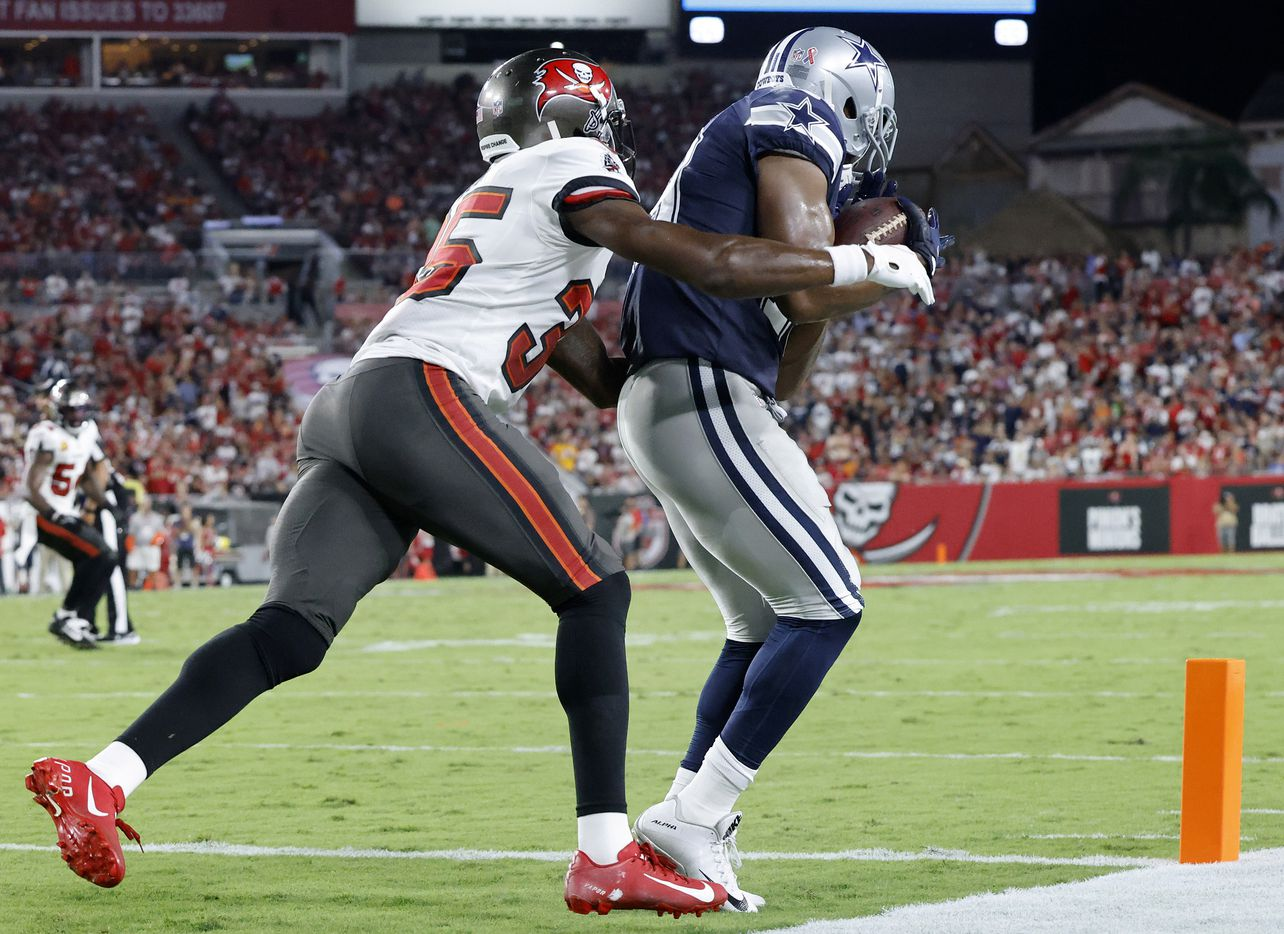 Dallas Cowboys wide receiver Amari Cooper (19) pulls in a second quarter touchdown pass in front of Tampa Bay Buccaneers cornerback Jamel Dean (35) at Raymond James Stadium in Tampa, Florida, Thursday, September 9, 2021. The Cowboys faced the Tampa Bay Buccaneers in the NFL season opener. (Tom Fox/The Dallas Morning News)