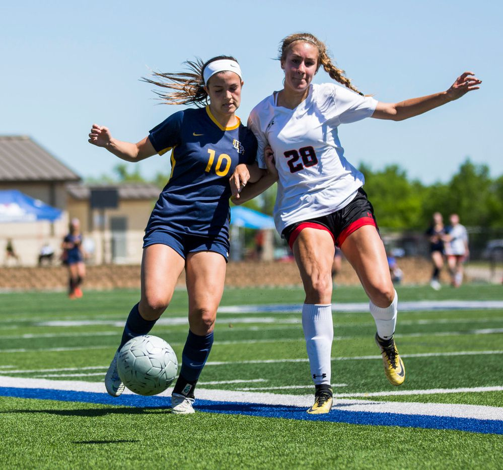 Highland Park forward Presley Echols (10) pushes off Mansfield Legacy defender Kaitlyn Johnson (28) during the UIL conference 5A girls state final soccer game between Mansfield Legacy and Highland Park at Birkelbach Field in Georgetown, Texas on Saturday, April 20, 2019. The score was tied 0 to 0 at the end of the first half.