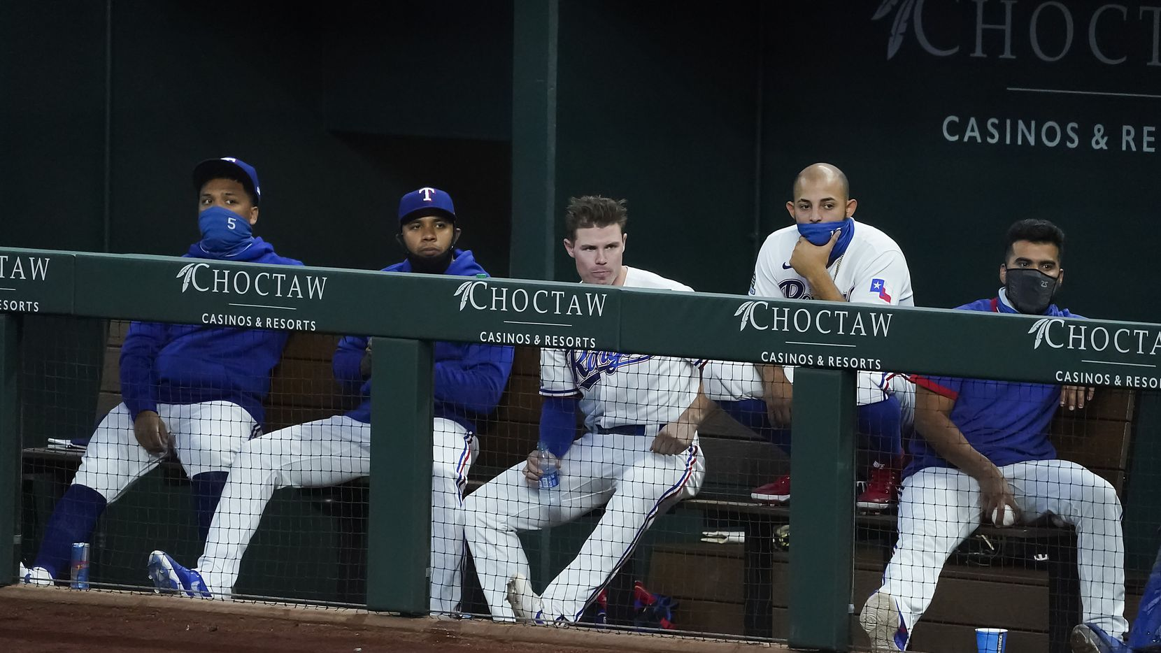 Texas Rangers players (from left) Willie Calhoun, Elvis Andrus, Scott Heineman, Robinson Chirinos and Rougned Odor watch from the dugout during the second inning against the San Diego Padres at Globe Life Field on Tuesday, Aug. 18, 2020.
