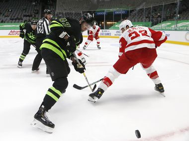 Stars right wing Alexander Radulov (47) rushes toward the puck as Red Wings defenseman Patrik Nemeth (22) defends during the first period of play at American Airlines Center on Thursday, Jan. 28, 2021,in Dallas.