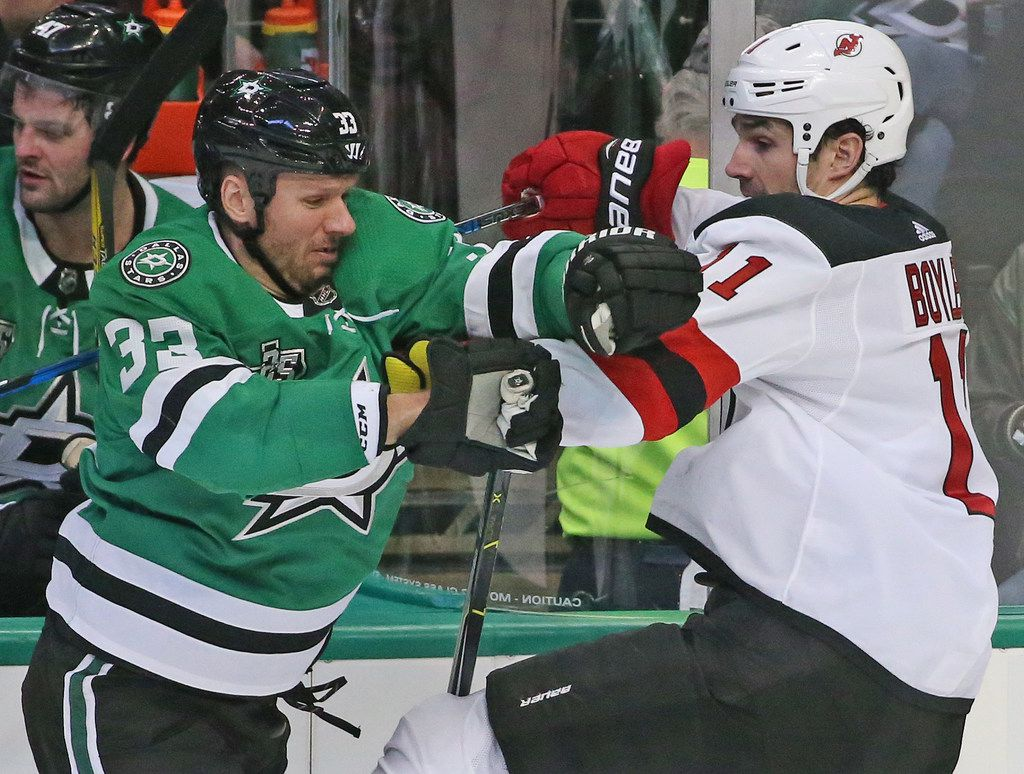 Dallas Stars defenseman Marc Methot (33) and New Jersey Devils center Brian Boyle (11) tangle along the boards in the second period during the New Jersey Devils vs. the Dallas Stars NHL hockey game at the American Airlines Center in Dallas on Thursday, January 4, 2018. (Louis DeLuca/The Dallas Morning News)