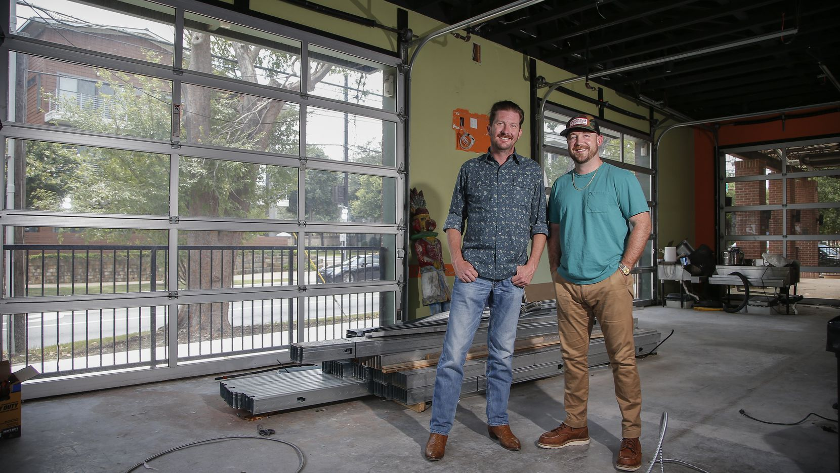 Garrett Mayer, left, and Austin Rodgers are transforming a former Jake's Burgers on Henderson Avenue into a restaurant/bar named Mayer's Garden. They're having a lot of fun combing through the 140-year-old bar's history.