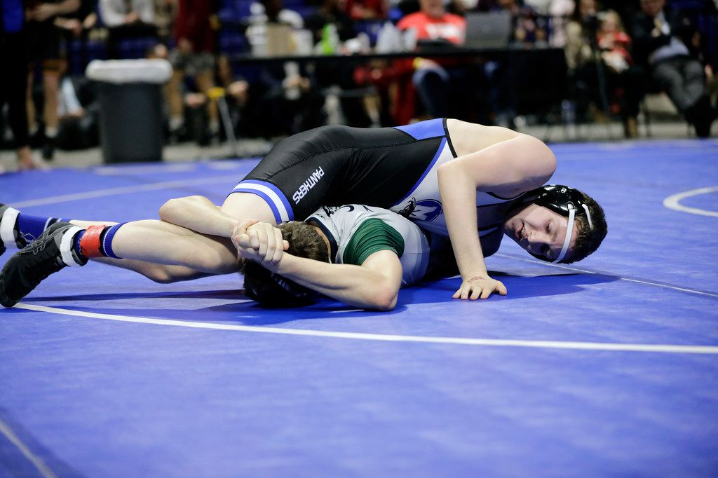 Jackson Carter of Midlothian wrestles during the UIL Texas State Wrestling Championships, Saturday, February 22nd, 2020, at the Berry Center in Cypress, Texas. Carter won the match.  Todd Spoth/Special Contributor ORG XMIT: hswrestlinglede_0223spo